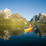 Grand Tetons National Park, Wyoming Kayaking on Jackson Lake is a way to travel into the heart of Grand Teton National Park, but have it all to yourself.  Want to camp under the stars? O.A.R.S. is the only outfitted paddler authorized to spend the night at the idyllic beach camp on Grassy Island. Photo: Justin Bailie